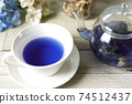 Butterfly pea blue herbal tea in a glass teapot and teacup 74512437