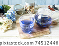 Butterfly pea blue herbal tea in a glass teapot and cup 74512446