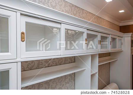 Classical style bookcase with glass doors and gilded handles 74528028