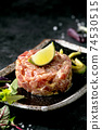 Tuna tartare with green salad 74530515