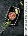 Tuna tartare with green salad 74530517