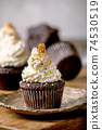 Chocolate cupcakes with caramel 74530519