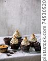 Chocolate cupcakes with caramel 74530520