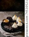 Chocolate cupcakes with caramel 74530521