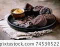 Chocolate cupcakes with caramel 74530522