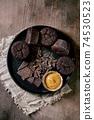 Chocolate cupcakes with caramel 74530523