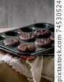 Fresh baked chocolate cupcakes 74530524