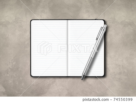 Black open lined notebook with a pen isolated on concrete background 74550399