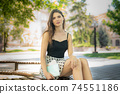 Girl student on a bench in the daytime 74551186
