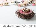 Quail easter eggs in nest and spring blomming flowers on blue. 74552018