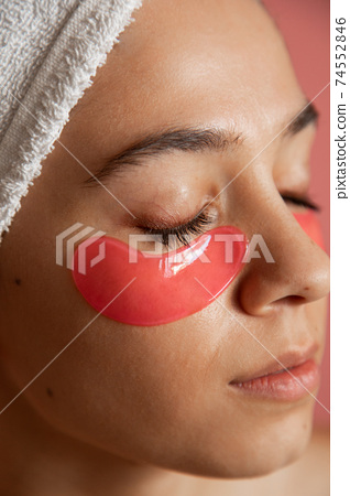 Woman with towel at her head closed her eyes 74552846