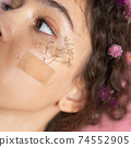 Girl having patch with wildflowers at her skin 74552905