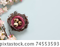 Easter composition with quail eggs in nest and spring flowers on blue. 74553593