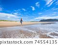 Woman Walking Beach Ocean Waterline 74554135