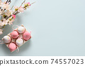 Easter pastel eggs and spring blooming flowers on blue. 74557023
