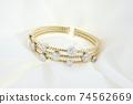 Yellow Gold Bracelet With Diamonds On Soft White Background 74562669