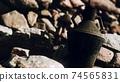 old metal jug at rocks 74565831