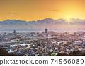 Toyama, Japan Skyline with Tateyama Mountain 74566089