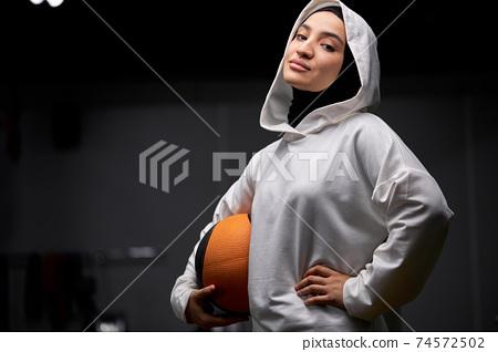 pretty adorable arabic sportswoman with ball in hands 74572502