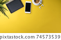 Flat lay top view office desk working space with tablet on yellow background. Copy space. 74573539
