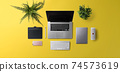 Flat lay top view office desk working space with laptop on yellow background. 74573619