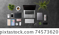 Flat lay top view office desk working space with laptop and supplies on gray background. 74573620