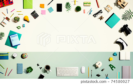 Collection of electronic gadgets and office supplies 74580027
