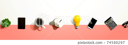 Office supplies with a piggy bank and a lightbulb 74580297