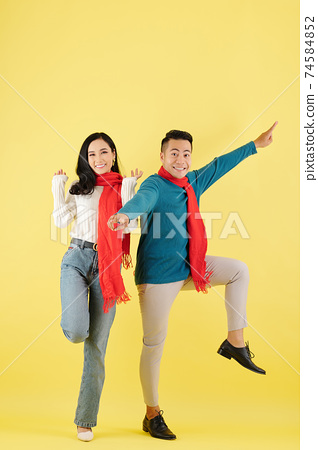 Couple dancing in winter clothes 74584852