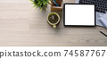 Horizontal photo of modern workspace with digital tablet, laptop, plant, coffee cup and copy space on wooden desk. 74587767