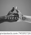 African and caucasian hands gesturing on gray studio background, tolerance and equality concept 74595726