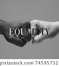 African and caucasian hands gesturing on gray studio background, tolerance and equality concept 74595732