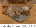 Sweet snack at the food court with pancakes with chocolate and coffee 74603319