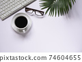 Top view of coffee with other supplies and keyboard on white background and copy space for insert text. 74604655