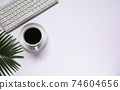 Top view of coffee with other supplies and keyboard on white background and copy space for insert text. 74604656