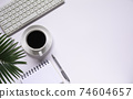 Top view of coffee with other supplies and keyboard on white background and copy space for insert text. 74604657