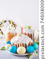 Easter cake and traditional painted eggs.  74608009