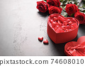 Heart giftbox and red roses on black. 74608010