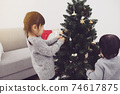 Christmas decorations and girls 74617875