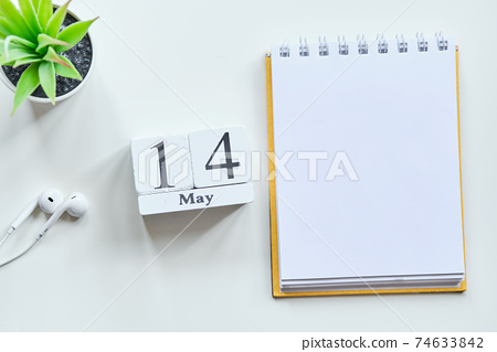 14 fourteenth day May Month Calendar Concept on Wooden Blocks. Copy space. 74633842