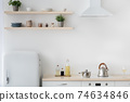White and wood material, little refrigerator, stove with kettle, bottles of sauces 74634846