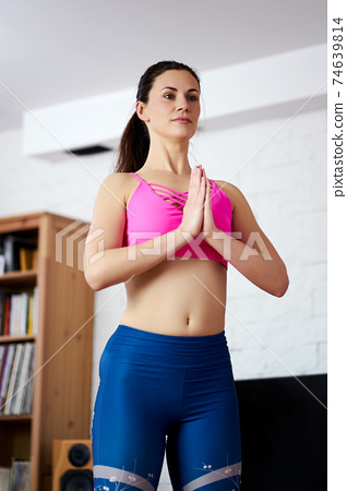 Young woman doing sports and yoga at home 74639814