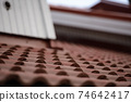 Closeup of Brown Roof Tiles of the House 74642417