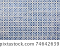 Portrait of mosaic tiles of abstract wall 74642639