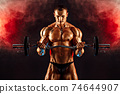 Strong sportsman lifting heavy dumbbell in smoke 74644907