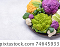 Purple, yellow, white and green color cauliflowers 74645933