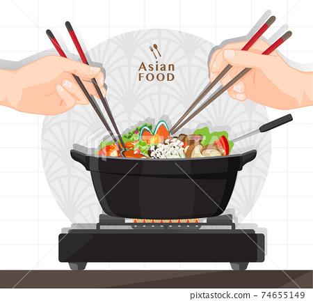 Shabu Shabu and Sukiyaki in hot pot at restaurant,  Hand holding chopsticks eating Shabu  shabu 74655149