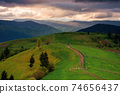 mountainous countryside scenery at sunset. dramatic sky above the distant valley. green fields and trees on the hill. beautiful nature scenery of carpathians 74656437