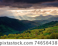 mountainous countryside scenery at sunset. dramatic sky above the distant valley. green fields and trees on the hill. beautiful nature scenery of carpathians 74656438