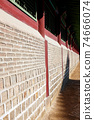 Ancient brick wall extending into the distance. Vertical composition. 74666074